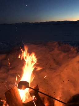 Marshmallow toasting on a fire in the snow