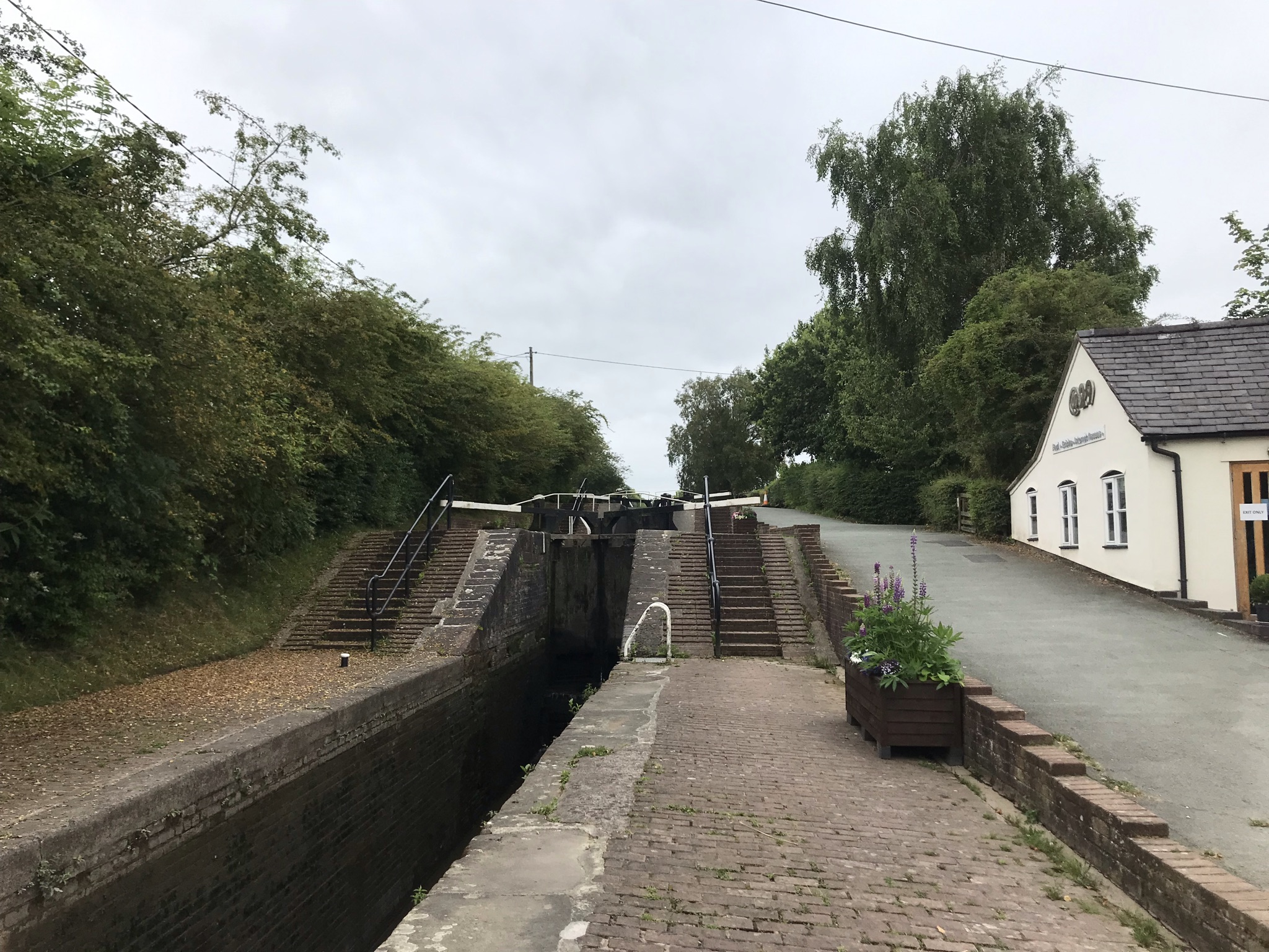 A lock with the water at the lowest level showing how deep it is.
